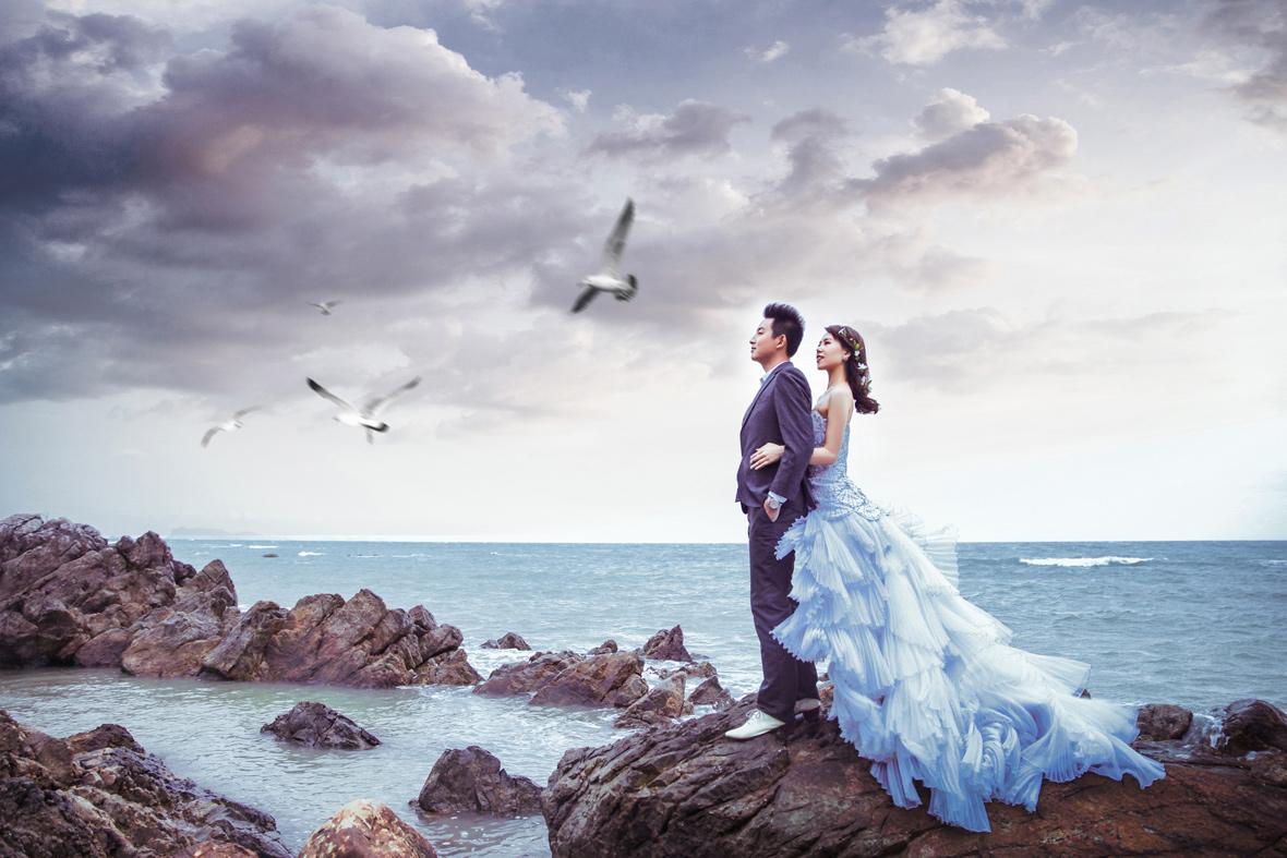沙滩婚礼 海边礁石夜景_西藏婚纱照_普吉岛婚纱照